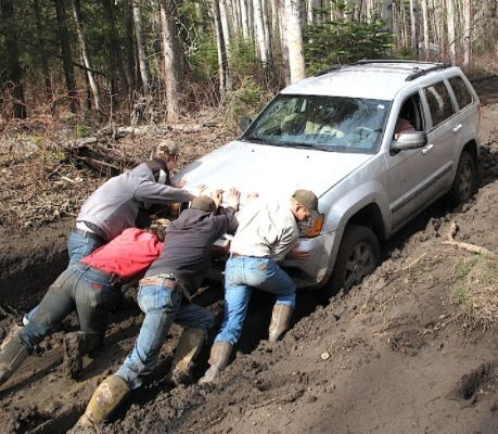 pushing car in mud